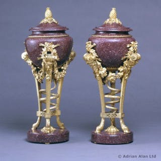 A Pair of Louis XVI Style Gilt-Bronze Mounted Porphyry Urns