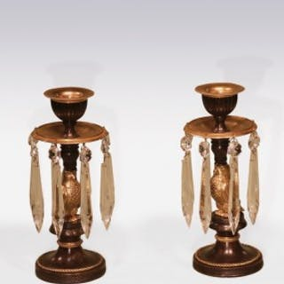 Pair of early 19th Century Bronze and Ormolu Lustre 'Horus' Candlesticks.
