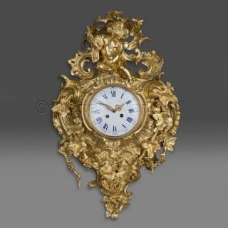 An Elaborate Louis XV Style Gilt-Bronze Cartel Clock