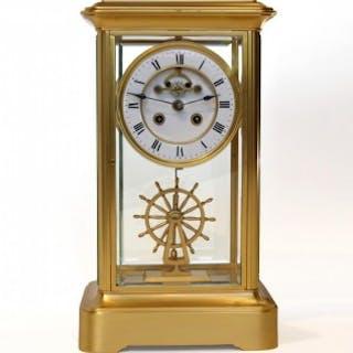 Four Glass Clock with ships wheel pendulum