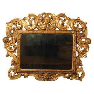 Carved giltwood Sansovino frame, with mercury mirror plate