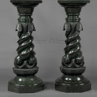 A Pair Of Green Serpentine Marble Pedestals Carved With Entwined Dolphins