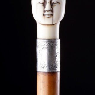 Victorian Silver Mounted Malacca Walking Cane with a Carved Ivory