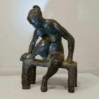 Uli Nimptsch (1897-1977) Nude sitting on bench holding her right foot c.1950