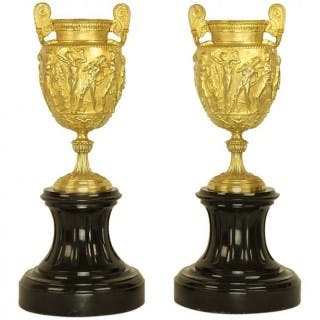Pair of Charles X gilt bronze Urns on black marble socle