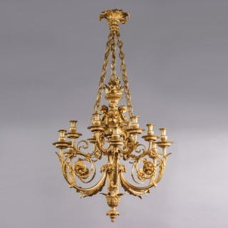 A Louis XVI Style Gilt-Bronze Cherub Twelve-Light Chandelier