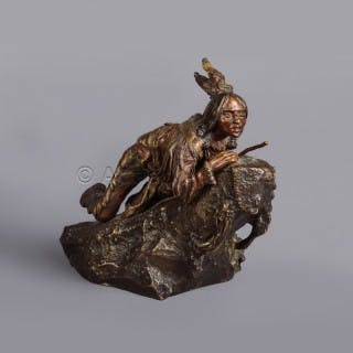 A Patinated Bronze Figure of A Native American Scout With Rifle