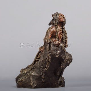 A Patinated Bronze Figure of A Native American Scout