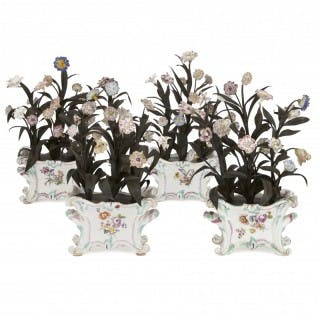 Four Meissen style painted porcelain and metal flower sculptures