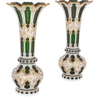 Two antique Bohemian white overlay and gilt green vases