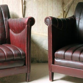 A Pair of French Modernist Burgundy Rexine & Leather Upholstered Armchairs