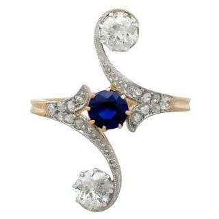 0.62ct Sapphire and 1.21ct Diamond, 14ct Yellow Gold Twist Ring -