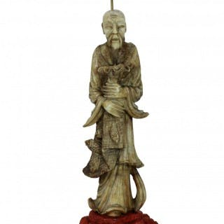 A MARBLE FLOOR LAMP OF A CHINESE FISHERMAN