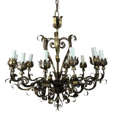 A GILT WROUGHT IRON CHANDELIER