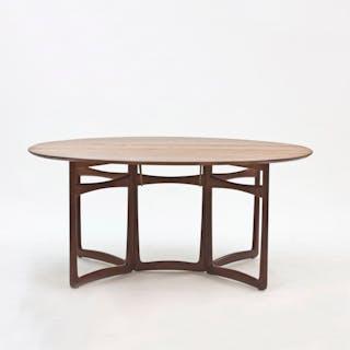 Teak dining table by Peter Hvidt and Orla Møllgaard
