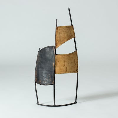 Leather and metal sculpture by Fred Leyman