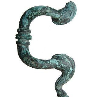 A Roman bronze handle in the form of a feline