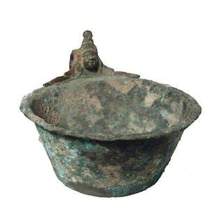 An attractive Roman bronze handled bowl