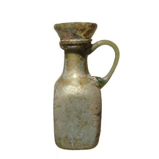 A nice little Roman green glass bottle