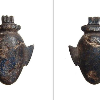 An Egyptian basalt ib heart amulet, Late Period