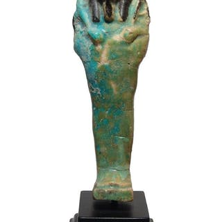 A large Egyptian bicolor faience ushabti, Ptolemaic
