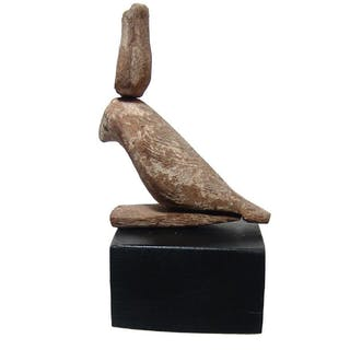 A nice Egyptian wooden falcon of Horus on plinth