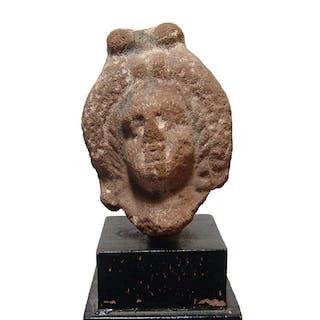 A Romano-Egyptian terracotta head of a woman