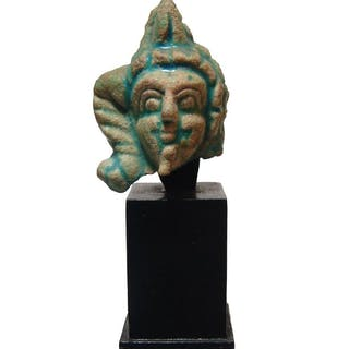 Egyptian glazed composition head of Harpokrates