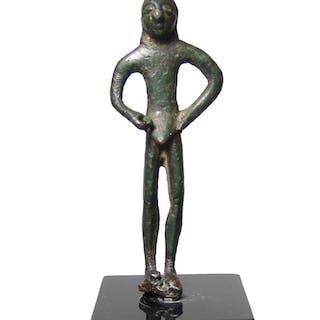 An Archaic Greek bronze male figure