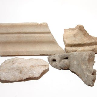 A group of 4 Roman marble fragments