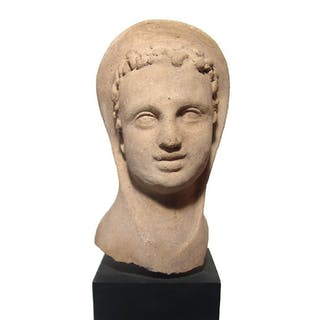 A charming Etruscan terracotta head of a youth