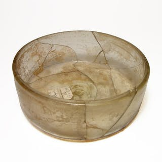 A large Roman yellow glass bowl