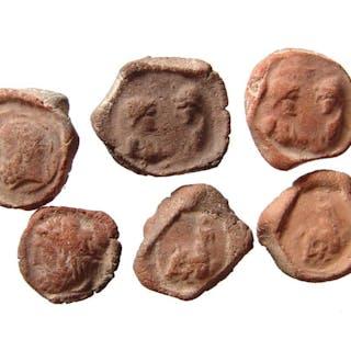 A group of 6 terracotta bullae, Roman