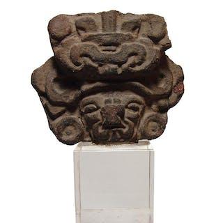 A Zapotec ceramic head of the deity, Oaxaca