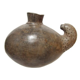 A large ovoid Chimu vessel in the form of a fruit