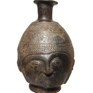 A handsome Inca Coquero head vessel