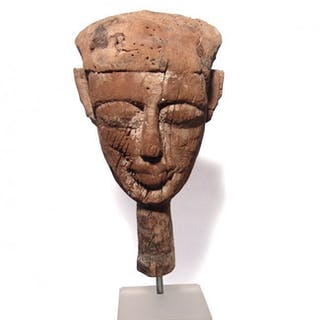 An Egyptian wood mummy mask, Late Period