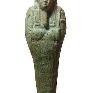 An Egyptian pale-green glazed faience ushabti