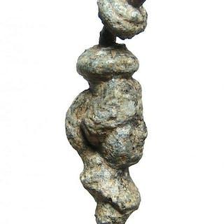 A Roman decorative element with a female head