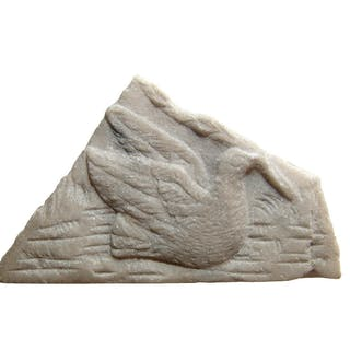 A Roman marble fragment depicting a dove