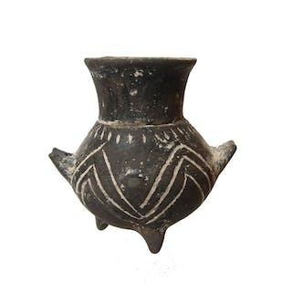 A rare Yortan culture black ceramic tripod jar, Troy I