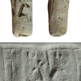 A Near Eastern faience cylinder seal