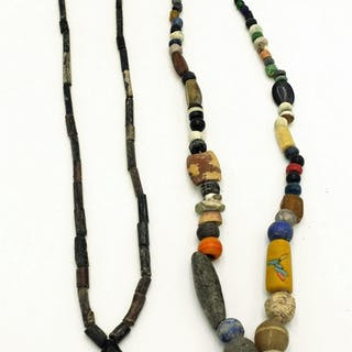 A pair of necklaces with assorted ancient beads