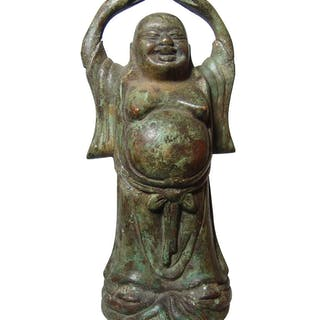 A bronze figure of the Laughing Buddha