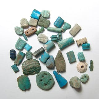 A group of Egyptian faience amulets & fragments