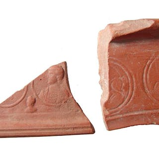 A pair of Roman pottery shards depicting emperors