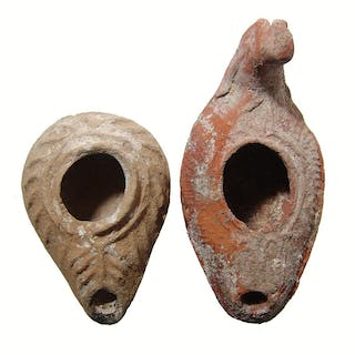 A pair of ancient ceramic oil lamps from the Holy Land