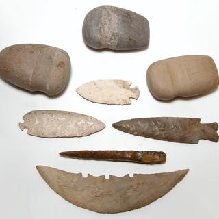 A group of Native American stone tools and weapons