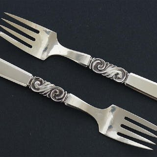 A Set of Nine Georg Jensen Sterling Silver Forks.