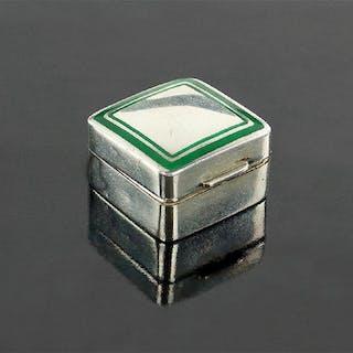 A Cartier Sterling Silver Pill Box.